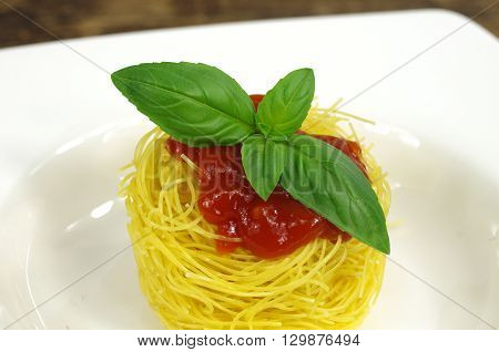 pasta macaroni with spice basil on white plate