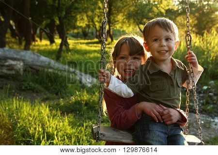 a very happy children on a swing