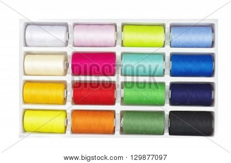 colourful threads in box on white background