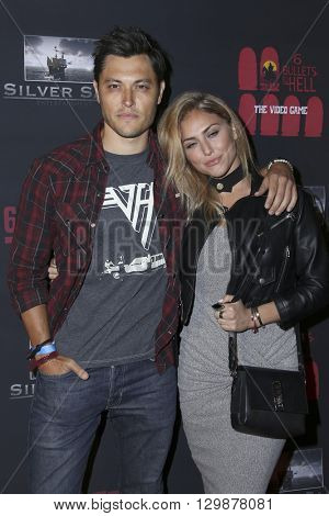 LOS ANGELES - MAY 10:  Blair Redford, Cassie Scerbo at the Launch of 8 Bullets to Hell at the Private Location on May 10, 2016 in Los Angeles, CA