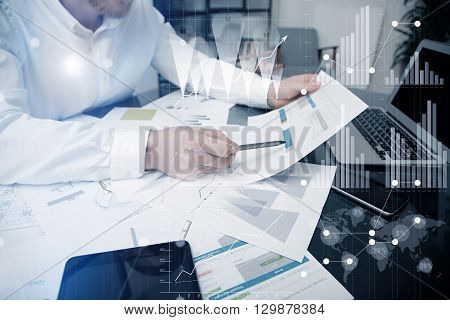 Investment manager working process.Photo bank trader work market charta.Using electronic devices.Graphic icons, worldwide stock exchanges interfaces on screen.Business project startup.Film effect
