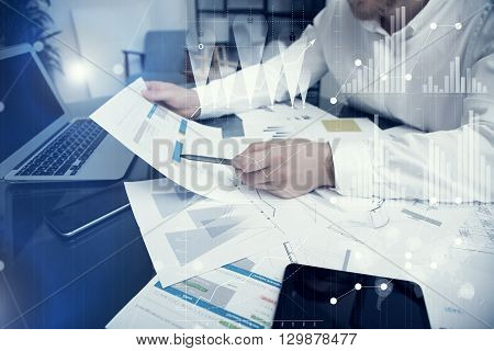 Banker manager working process.Photo bank trader work market charta.Using electronic devices.Graphic icons, worldwide stock exchanges interfaces on screen.Business project startup.Film effect.