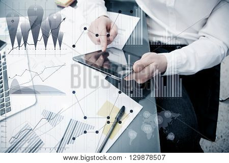Banker manager working process.Photo bank trader work market charts.Using electronic devices.Graphic icons, worldwide online stock exchanges interfaces on screen.Business project startup.Film effect.