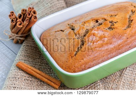 Delicious fresh homemade cinnamon loaf cake in the ceramic dish