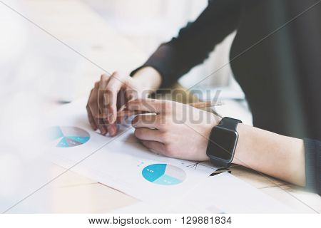 Picture Woman Working Modern Office.Girl Wearing Generic Design Smart Watch.Female Hands holding pencil. Account Manager Work Process at Wood Table.Horizontal mockup.Burred Background. Film effect.