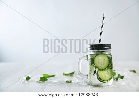 Rustic Jar With Cold Fresh Homemade Mojito Without Alcohol Made With Cucumbers, Mint Leaves And Ice.