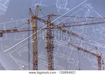 Blueprints and construction cranes concept of architecture