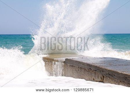 big sea waves breaking on breakwater, blurred motion