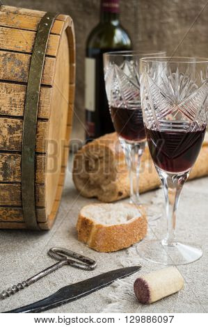 Octave bread and two wineglasses are on sacking