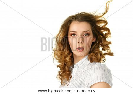 Young Woman With Hair Flying Under Wind