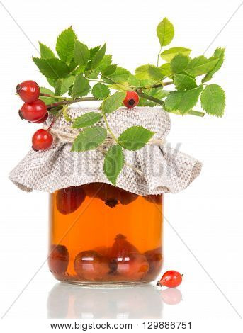 Bank with rosehip drink isolated on white background.