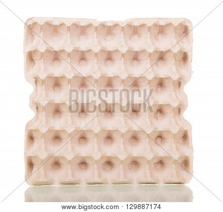 Empty cardboard tray of eggs isolated on white background.