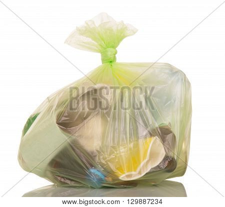 Garbage bags with household waste isolated on white background.