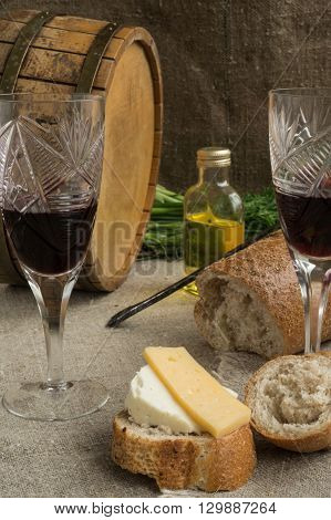 Octave wineglass vegetable oil bread and cheese are on sacking