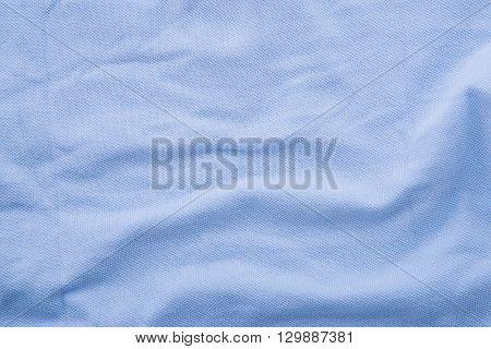Close up of beautiful wrinkle sky blue fabric texture.