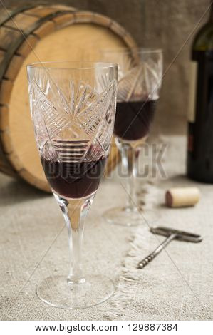 Old octave and two wineglasses are on sacking