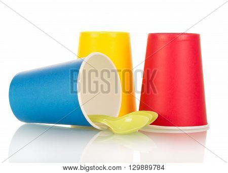 Multi-colored disposable plastic cups and spoons isolated on white background.