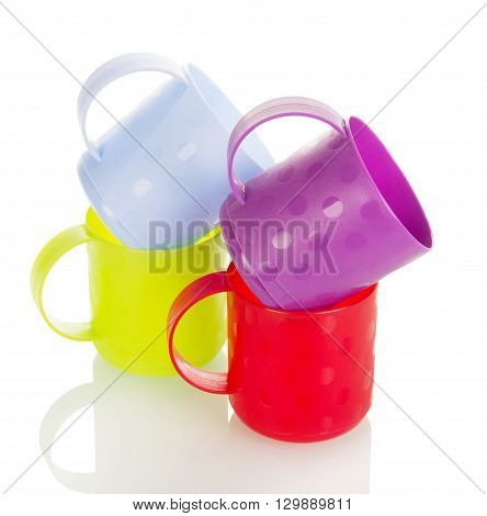 Colorful plastic cups isolated on white background.