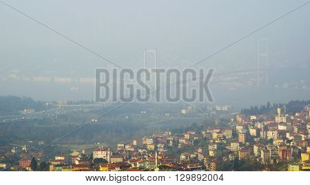 Istanbul Turkey - January 5 2014: In the morning due to heavy fog suddenly collapsed and continues to impact ferry in time delays have been experienced.Istanbul Bosphorus Bridge foggy view.