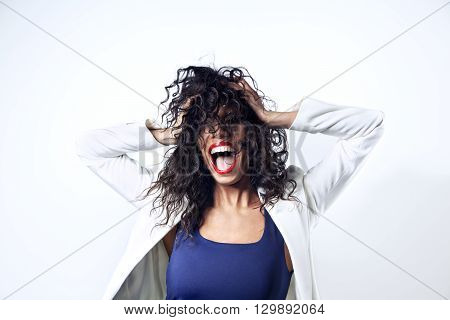Black woman with long hair yelling, emitions. Red lipstick opened mouth
