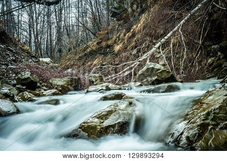 beautiful landscape with mountain clear river flowing over stones