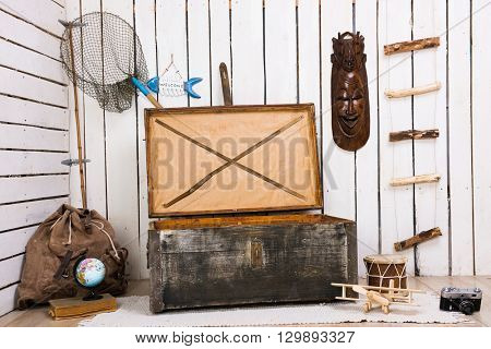 decorated room with big old wooden chest at centre