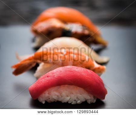 close up of sashimi sushi set on black tray
