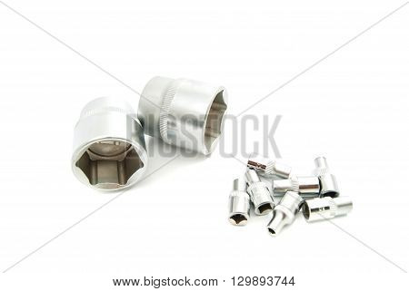 Heads And Nozzle Wrenches On White