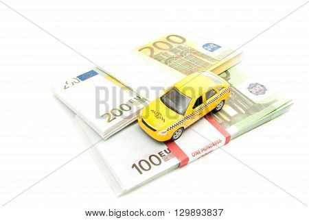 Taxi Car And Banknotes On White