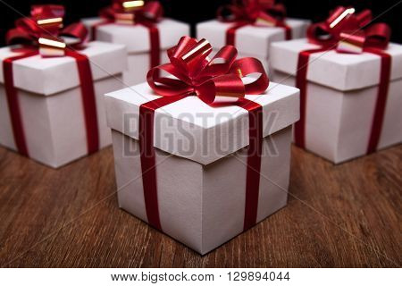 small gift boxes on the table on a black background