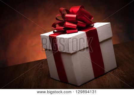 one large white gift box on a wood background