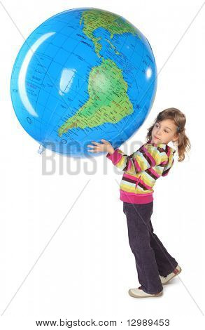 little girl standing and holding big inflatable globe over her head, side view, looking left, isolated on white