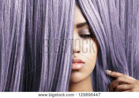 woman look out from violet hair creative colored
