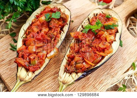 Cooked Eggplant and stuffed with vegetables on board.