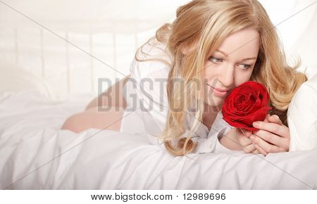 Girl In Bed With Rose