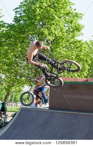 Sankt-Petereburg, Russia - May 15 2016: the man is engaged in cycle freestyle on the platform with hills. In St. Petersburg in parks many people are engaged in active sports