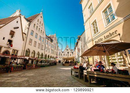 Tallinn, Estonia - July 26, 2014: People resting In Street Cafe In Old Town Of Tallinn