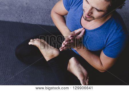 Mexican yoga teacher meditating