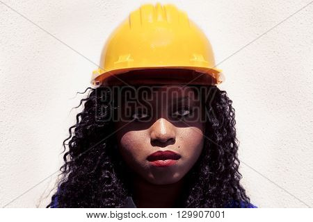 Portrait Of Young African American Female Worker With Yellow Helmet