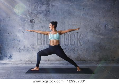Young woman practicing yoga with beautiful sunlight.