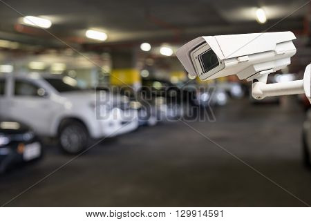 CCTV security camera on blur car parking