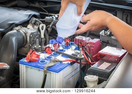 car battery maintenace with distilled water, garage
