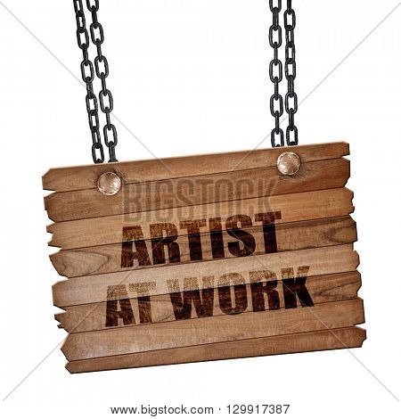 artist at work, 3D rendering, wooden board on a grunge chain