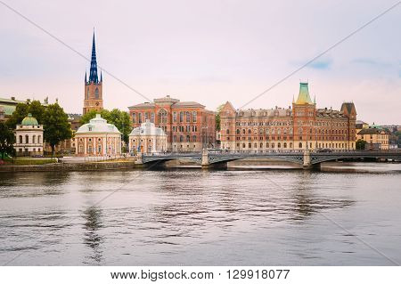 Stockholm, Sweden. The Vasa Bridge To Gamla Stan Over Norrstrom, With The Riddarholmen Church Tower On Background.