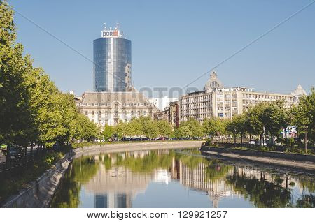 Bucharest, ROMANIA - April 22 2016: View of Dambovita river and BCR tower in Izvor area, near the Parliament building. BUCHAREST -April 22 2016