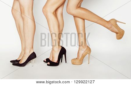 three pair of woman legs in hight heels shoes elegant fashion people concept, modern girl spa casual