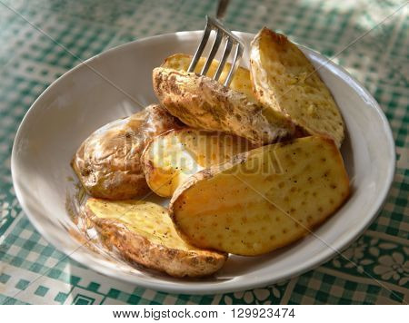 Tempting close-up of jacked potato that is was baked in oven with perforation by fork.