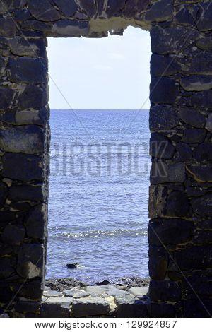 Looking through doors to wards blue sea