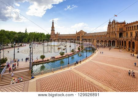 Seville, Spain - April 30, 2016: View across  Plaza de Espana, where tourist are visiting the famous tile-work.