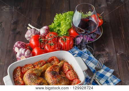 Fried chicken drumsticks and vegetables with red wine